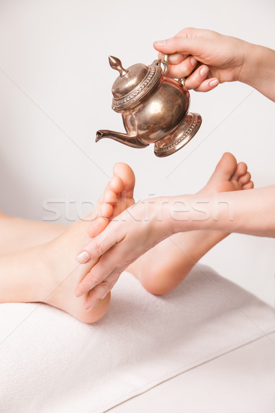 ayurvedic foot therapy massage procedure with oil Stock photo © julenochek