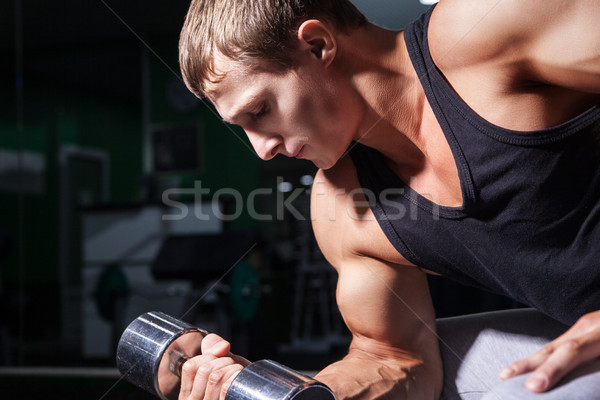 Close-up of bodybuilder doing concentration curls Stock photo © julenochek