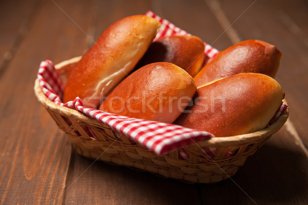 Pies of puff pastry close up in a basket.  Stock photo © julenochek