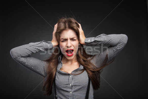 Woman screaming because of headache. Stock photo © julenochek
