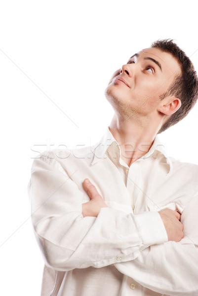 Jóképű mosolyog fiatalember felfelé néz izolált fehér Stock fotó © julenochek