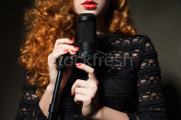 Close-up of curly-haired woman with mic Stock photo © julenochek