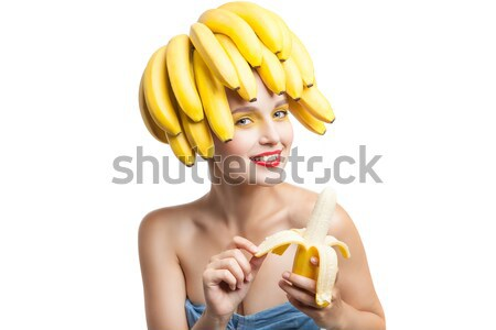 Excited model with bananas on head holding one in hand Stock photo © julenochek