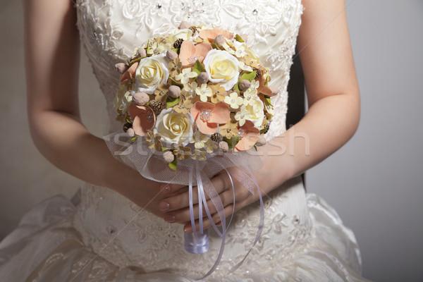 Bride is holing wedding flowers. Focus on flowers Stock photo © julenochek