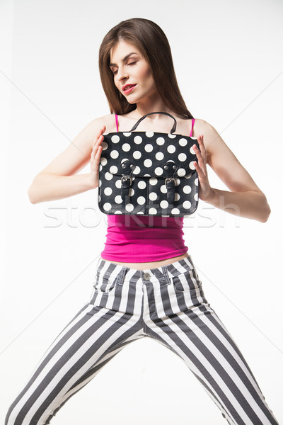 Fashionable girl with bag in hands Stock photo © julenochek