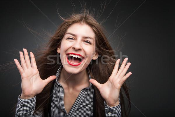 красивой женщины улыбаясь Flying волос ладонями Сток-фото © julenochek