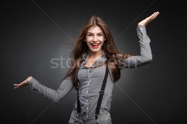 Joyful woman posing with her hands up Stock photo © julenochek