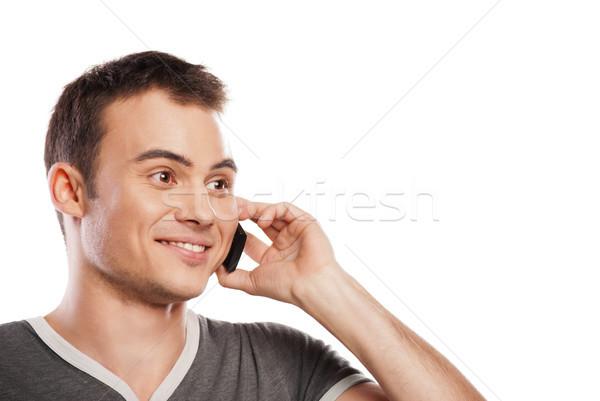 Happy man answering the phone isolated Stock photo © julenochek