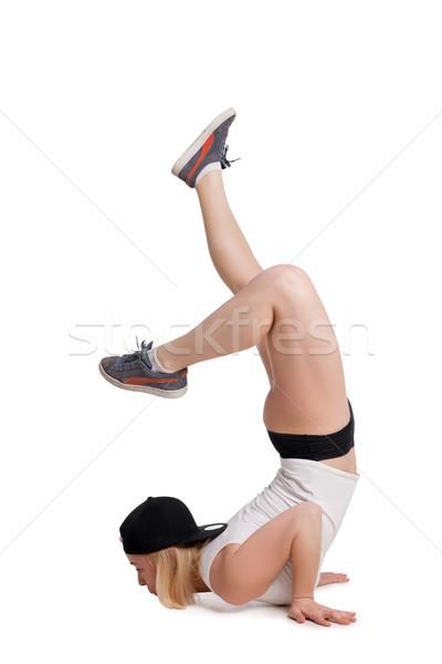 Mulher em pé mãos pé para cima isolado Foto stock © julenochek