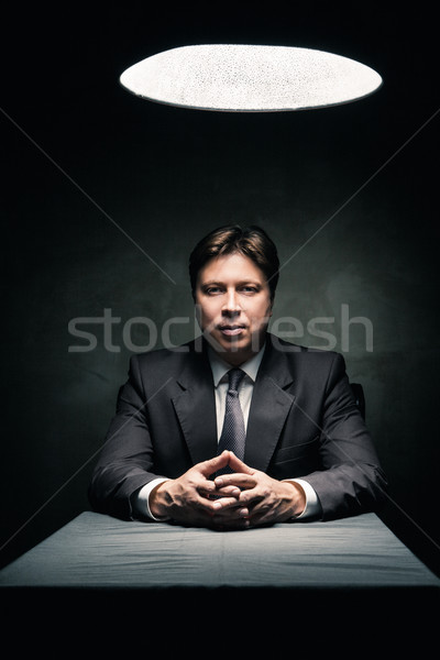 Man wearing suit in dark room illuminated by lamp Stock photo © julenochek