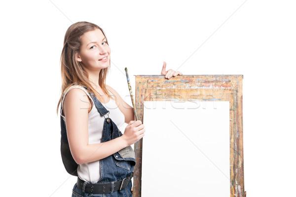 молодые улыбающаяся женщина художника кисти Постоянный мольберт Сток-фото © julenochek