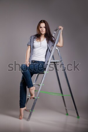 Young smiling woman  standing at easel , hugging palette Stock photo © julenochek