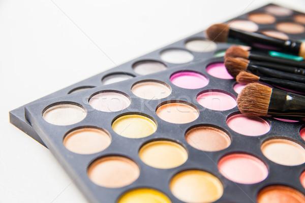 Makeup brushes and make-up eye shadows Stock photo © julenochek