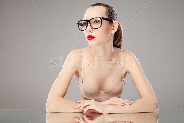 Portrait of young woman in glasses and bra looking away Stock photo © julenochek