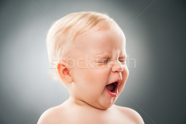 baby with squint eyes and open mouth Stock photo © julenochek