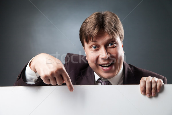 Adult businessman pointing at blank space Stock photo © julenochek