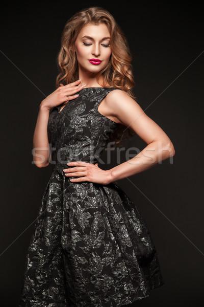 Attractive young woman in dress posing in studio Stock photo © julenochek
