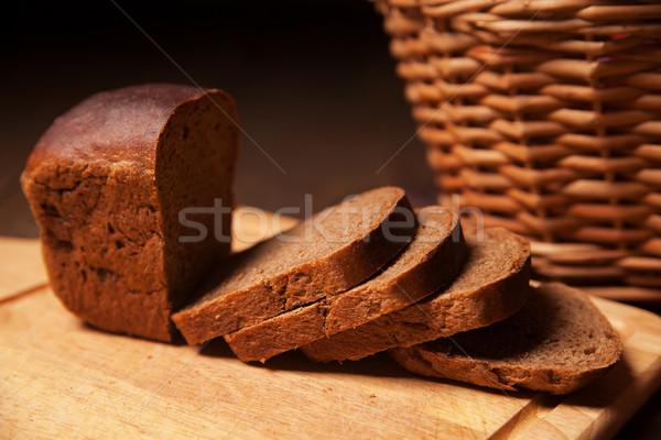 Sliced rye bread and basket closeup Stock photo © julenochek