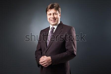 Sikeres üzletember mosolyog kamera portré öltöny Stock fotó © julenochek