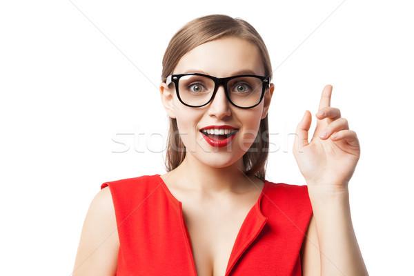 Portré mosolygó nő mutatóujj felfelé fiatal nő szemüveg Stock fotó © julenochek