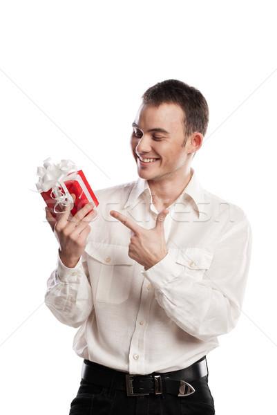 улыбаясь человека указывая подарок белый портрет Сток-фото © julenochek