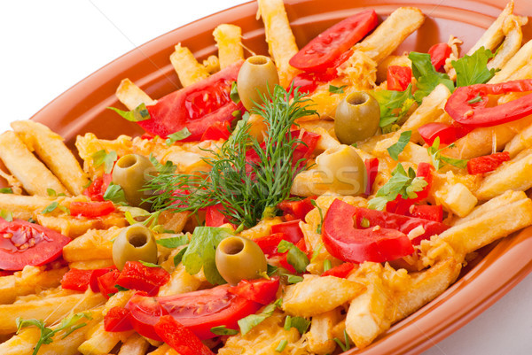 golden French fries potatoes with tomato and olive Stock photo © julenochek