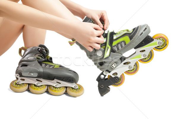 Woman lacing up rollers  Stock photo © julenochek