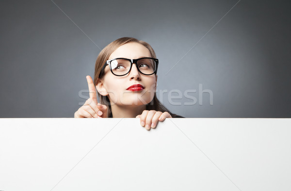 woman with finger up looking at camera Stock photo © julenochek