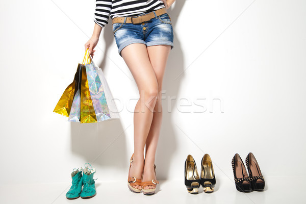 Woman's legs, shopping bags and shoes Stock photo © julenochek