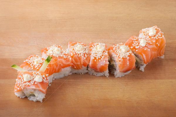 Closeup japanese sushi on wooden plate Stock photo © julenochek