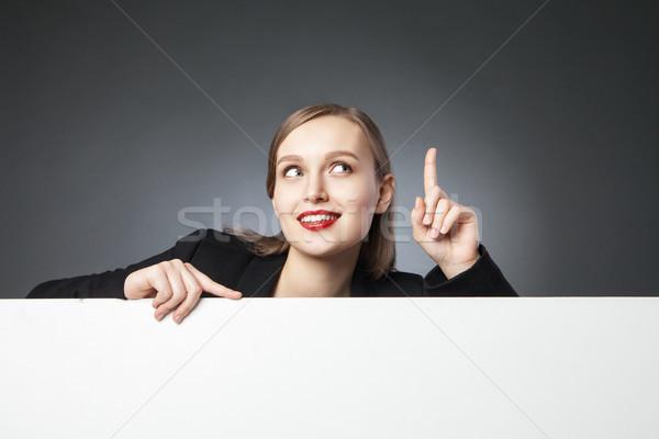 улыбаясь деловая женщина пальца вверх красивой Сток-фото © julenochek