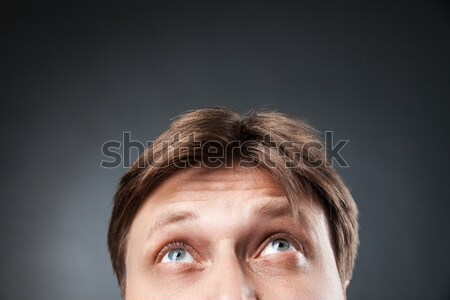 Close-up of adult man looking up Stock photo © julenochek