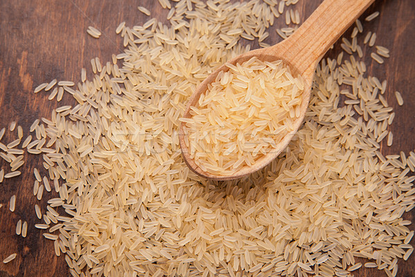 uncooked rice with spoon and woody background Stock photo © julenochek