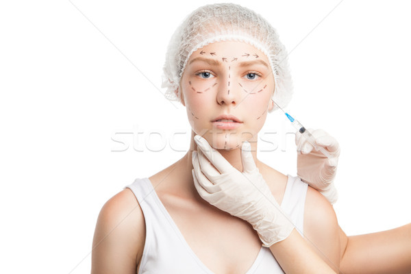 Stock photo: Doctor making injection into girl's face