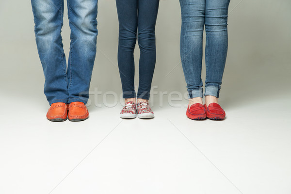 barefoot  legs of mother, father and little child wearing  jeans  Stock photo © julenochek