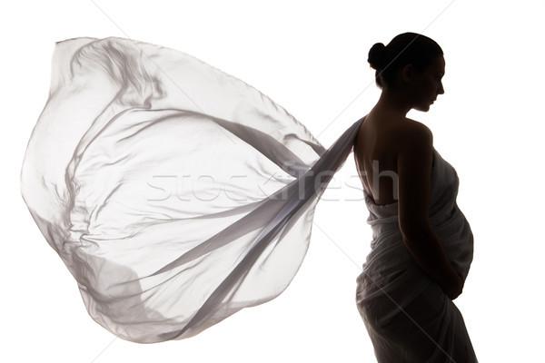 Beautiful pregnant woman in white chiffon shawl Stock photo © julenochek