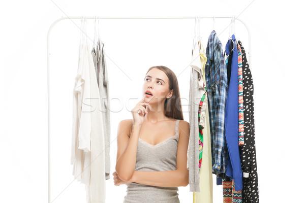 Nadenkend brunette naar kleding portret denken Stockfoto © julenochek