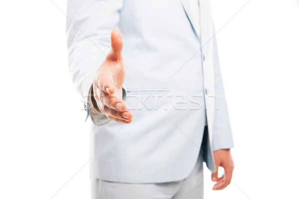 Close up of businessman hand extended to handshake isolated on white  Stock photo © julenochek