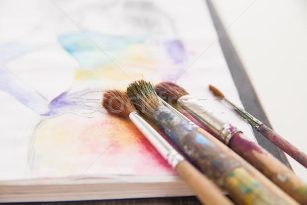 paint brushes lying on painted background Stock photo © julenochek