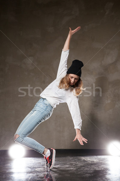 Young woman in black hat dancing on tiptoe Stock photo © julenochek