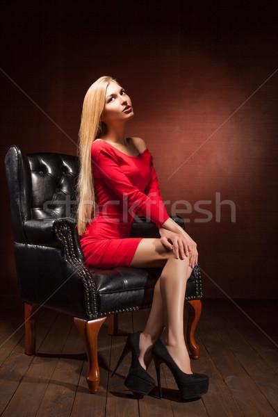 Gyönyörű nő visel vörös ruha ül divat lövés Stock fotó © julenochek