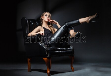 portrait of beautiful blonde lying in armchair with wine glass Stock photo © julenochek