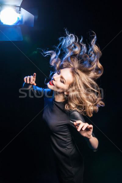 Zijaanzicht blonde vrouw wild haren jonge Stockfoto © julenochek