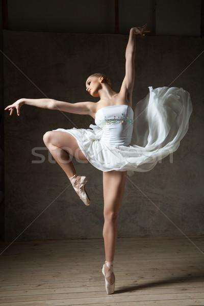 Beautiful ballerina dancing in white dress Stock photo © julenochek