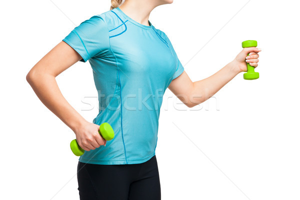Athletic woman works out with green dumbbells Stock photo © julenochek