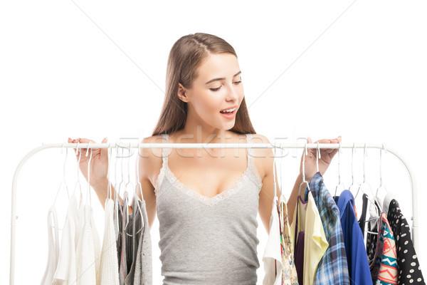 Excitado morena mirando hacia abajo ropa retrato sonriendo Foto stock © julenochek