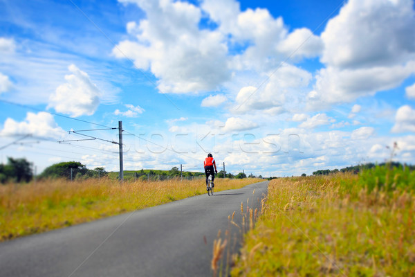 Stock photo: A cyclist on an empty rural road