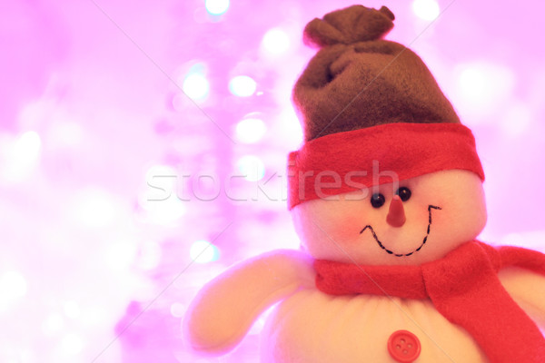 Smiling snowman against christmas lights Stock photo © Julietphotography