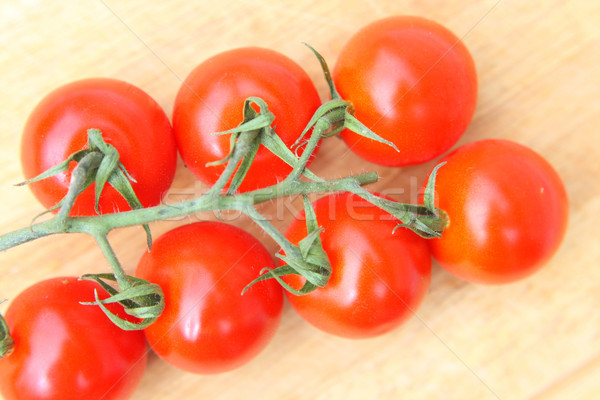 Cherry tomatoes on wooden table close up Stock photo © Julietphotography