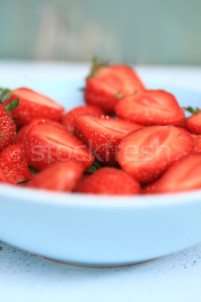 Fresh strawberries in a blue bowl, close up Stock photo © Julietphotography